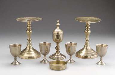 A GROUP OF BRASS SERVING OBJEC
