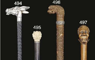 A caved wood walking stick
