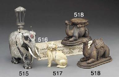 A Goan carved ivory dog