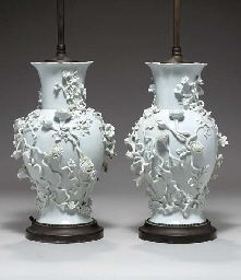 A PAIR OF WHITE BALUSTER VASES