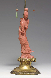 **A CHINESE CORAL FIGURE OF A