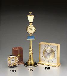 Cartier. A gilt world time tab