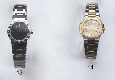 A LADY'S STAINLESS STEEL 18K G
