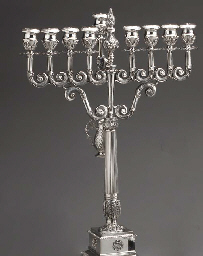 A STERLING SILVER MENORAH, BY