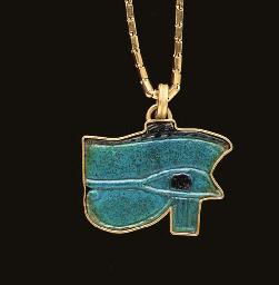 AN EGYPTIAN FAIENCE WADJET-EYE