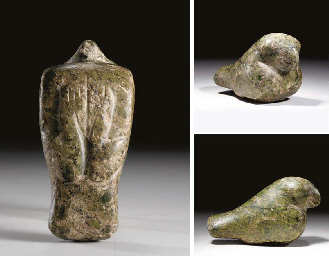 AN EGYPTIAN SERPENTINE STATUE