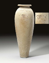 AN EGYPTIAN POTTERY WAVY-HANDL