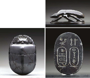 AN EGYPTIAN HEMATITE SCARAB IN