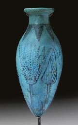 AN EGYPTIAN FAIENCE LOTUS VESS