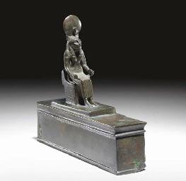 AN EGYPTIAN BRONZE FIGURE OF B