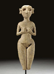 A MESOPOTAMIAN IVORY STANDING