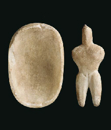 A CYCLADIC MARBLE IDOL AND BOW
