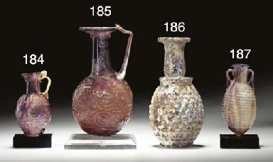 A ROMAN GLASS GRAPE FLASK