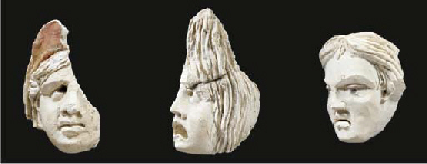 THREE PALMYRENE STUCCO HEADS