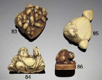 An ivory netsuke of a reclinin