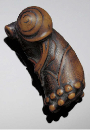 A wooden netsuke of a snail on