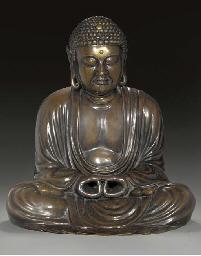 A large bronze model of Buddha