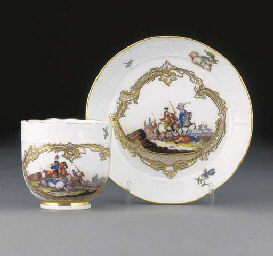 A Meissen coffee cup and sauce