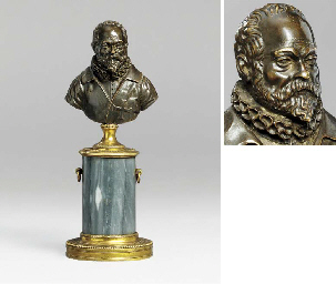 A BRONZE SELF-PORTRAIT BUST OF