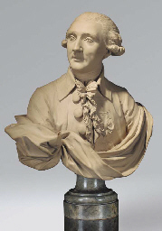 A PATINATED PLASTER BUST OF A