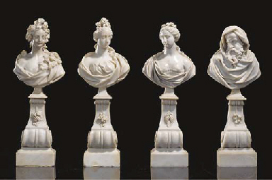A SET OF FOUR CARVED MARBLE BU