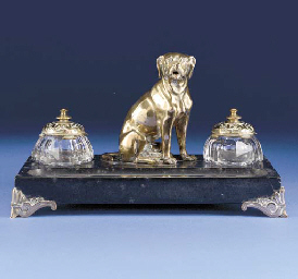A marble inkwell mounted with