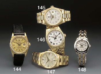 ROLEX: AN 18ct. GOLD DAY-DATE
