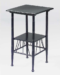 AN EBONISED OCCASIONAL TABLE
