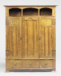 AN OAK AND INLAID CABINET