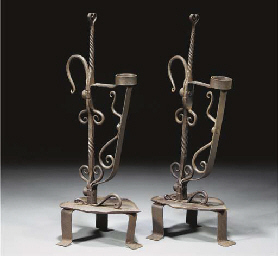 A Pair of Wrought Iron Reed-Bu