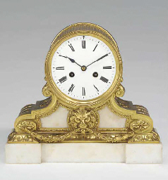 A French gilt-brass and white