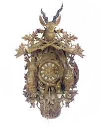 A Black Forest carved wood lar