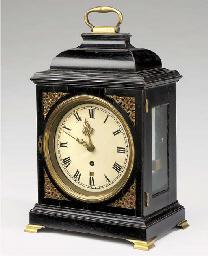 A George II ebonised and brass