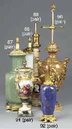 A pair of painted and gilt-hei