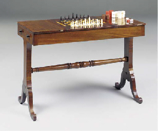 A ROSEWOOD GAMES TABLE