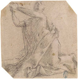A kneeling man looking up; and