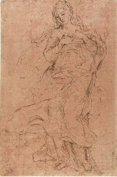 A female figure clasping her h