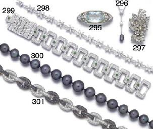 A diamond and cabochon emerald