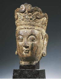 a chinese lime stone head of g