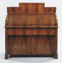 A late Biedermeier mahogany cy