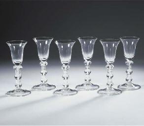 (6) A set of six white opaque-