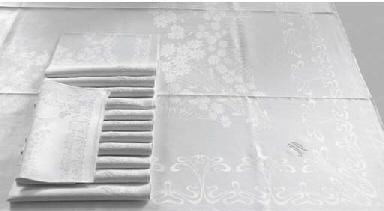 (13) A fine damask linen table
