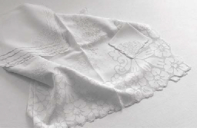 (13) An embroidered linen tabl