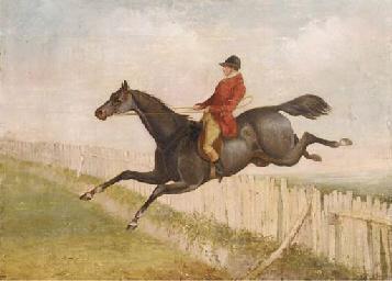 A huntsman on horseback jumpin