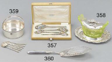 Four Russian enamel spoons, in