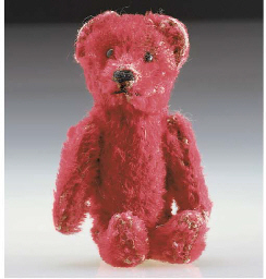 A Schuco miniature teddy bear