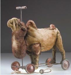 A Steiff camel on wheels