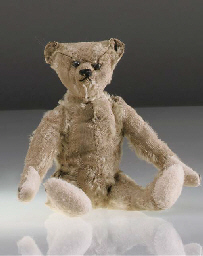 A small Steiff teddy bear