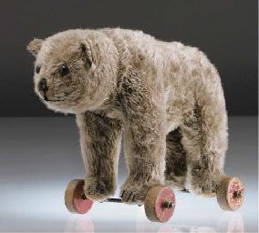 A Steiff bear on wheels