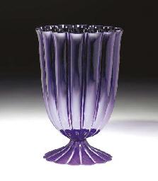 A PURPLE GLASS VASE